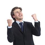 Euphoric successful businessman raising arms