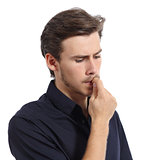 Young man stressed or worried biting nails