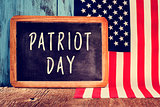 text Patriot Day in a chalkboard and the flag of the United Stat