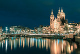 Night Amsterdam canal and Basilica Saint Nicholas