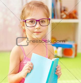 Little clever schoolgirl