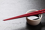 Japanese sushi chopsticks over soy sauce bowl