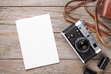 Vintage film camera and blank photo frame