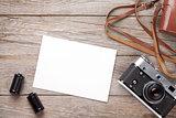 Vintage film camera and blank photo frame