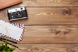 Camera and supplies on office wooden desk