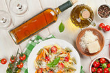 Colorful pasta and and white wine