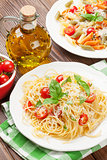 Spaghetti and penne pasta with tomatoes and parsley