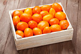 Orange tomatoes box