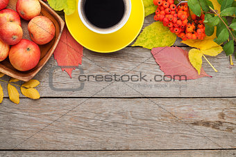 Autumn leaves, apple fruits and coffee cup