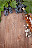 Red grape, wine bottle and corkscrew