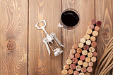 Wine bottle shaped corks, glass of wine and corkscrew
