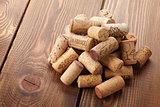 Wine corks heap over rustic wooden table background