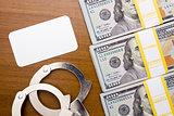 Bribe dollar near the handcuffs