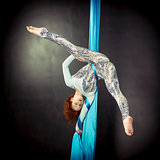 Gymnast training on aerial silks