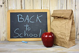 back to school sign on chalkboard