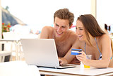 Couple buying online on holidays