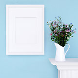 Mock up poster and wildflowers on a dresser with blue wall