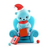 Teddy bear with Christmas box sitting on a sofa, clipping path