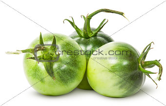 Three green tomatoes near