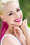 Smiling Woman With Blond and Magenta Pink Hair