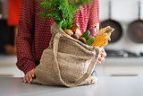 Closeup of burlap sac filled with autumn vegetables