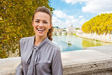 Elegant, happy woman near Tiber River in Rome