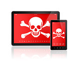 Digital tablet PC and smartphone with a pirate symbol on screen.