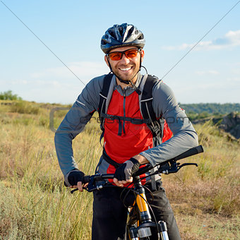 Portrait of Young Cyclist in Helmet and Glasses
