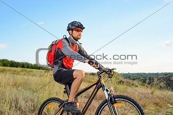 Cyclist Riding the Bike on the Beautiful Summer Mountain Trail. Sport Concept.