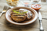 Beef steaks on the wooden background