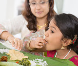 Indian girl eating