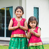 Cute Indian girls in sari greeting