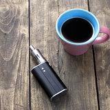 e-cigarette and cup of coffee