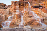 The waterfall on red rock in Egypt at summer