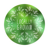 Locally grown - product label on blurred background.