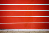 Red and white lined plaster wall