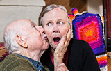 Older Gentleman Kissing Older Woman on Cheek