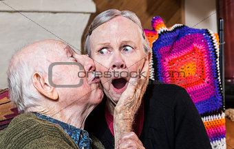 Older Gentleman Kissing Older Woman on Cheek