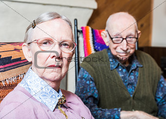 Old Woman and Man Sitting in Livingroom