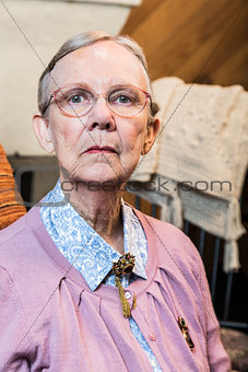 Old Woman Sitting Sternly