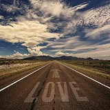 Conceptual Image of Road with the Word Love