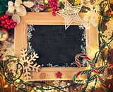 Christmas background with board in wooden frame and garland