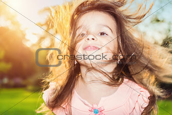 Beautiful little girl posing outdoors
