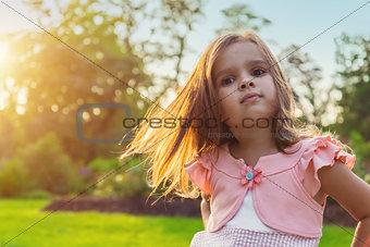 Beautiful little girl posing outdoors
