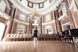 elegant lady in classic concert hall