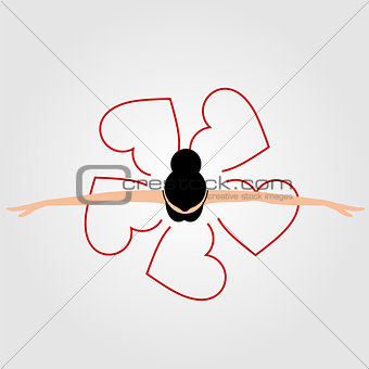 Top view dancing ballerina wearing abstract heart dress
