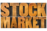 stock market text in wood type
