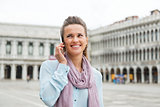 Woman talking on mobile in St. Mark's Square
