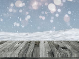 Wooden table with defocussed snowy landscape