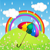 Rainbow color umbrella in raining sky